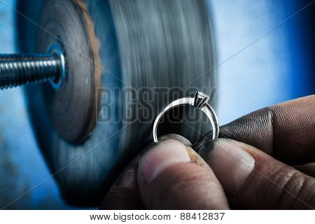 Jeweler working on wedding gold ring