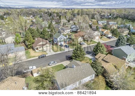 FORT COLLINS, CO, USA - APRIL 18, 2015: Aerial view of Fort Collins street, a typical residential neighborhood along Front Range of Rocky Mountains in Colorado,  early spring
