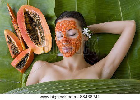 Beautiful Woman Having Fresh Papaya Facial Mask Apply. Fresh Papaya