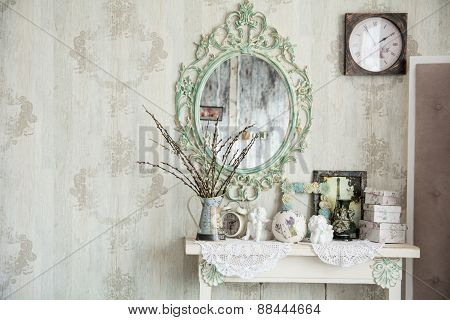 Vintage Interior With Mirror And A Table With A Vase And Willows