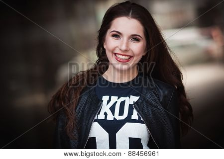 The Laughing Young Girl In A Leather Jacket
