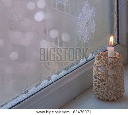 Winter Window With Burning Candle