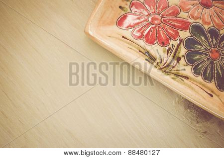 Yellow Porcelain Tablemat On A Pastel Green Background