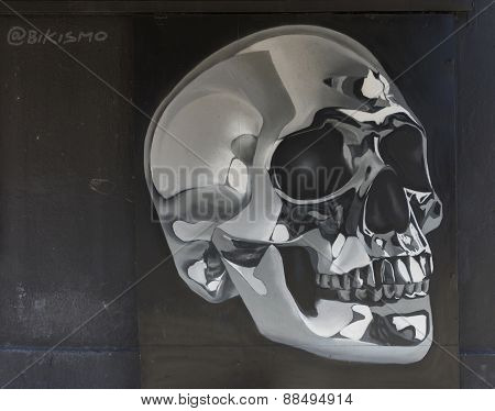 Black And White Graffiti Of Skull.
