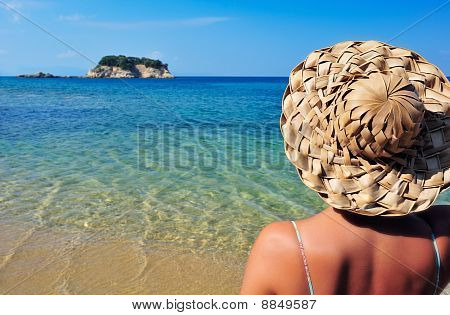 Young Woman In Hat Looking At Small Island