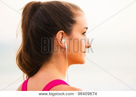Young Fitness Woman with Smart Phone Ready for Workout. Fitness Technology Concept.