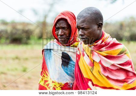 Two Massai men walking together