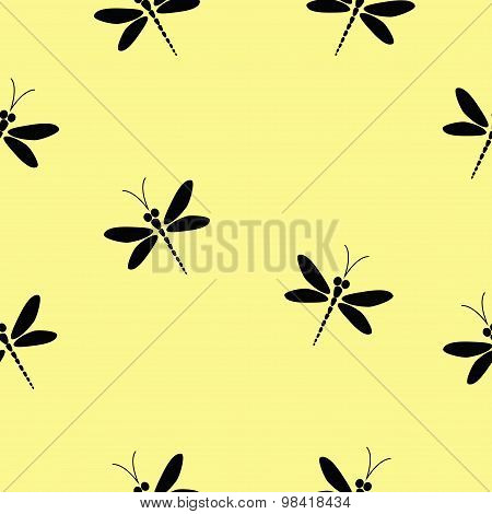 Vector seamless pattern with black dragonflies on the soft yellow background