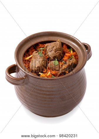 delicious indian dum biryani lamb served in pottery isolated on white background poster