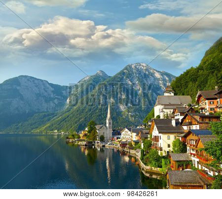 Hallstatt  village and alpine lake in morning lights. Austrian Alps