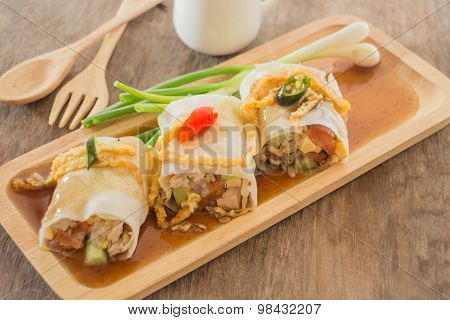 Spring Rolls With Vegetables And Chicken On Wooden Plate