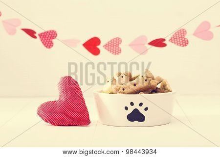 Dog Treats On A White Bowl With A Heart Cushion