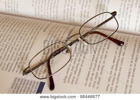 glasses agains a book