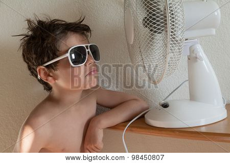 boy cools with a fan, portrait