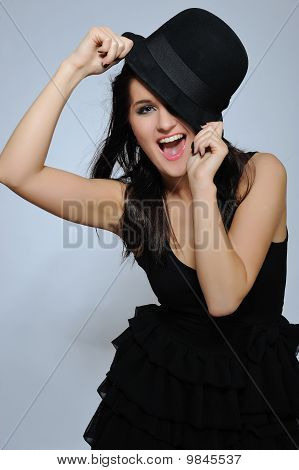 Expressions. Beautiful Sexy Woman With Slim Body In Elegant Dress And Hat Smiling