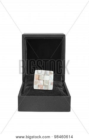 Nacre chess brooch in black box isolated over white poster