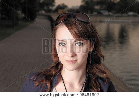 Unadorned beauty. Young redhead women no makeup looking at camera.