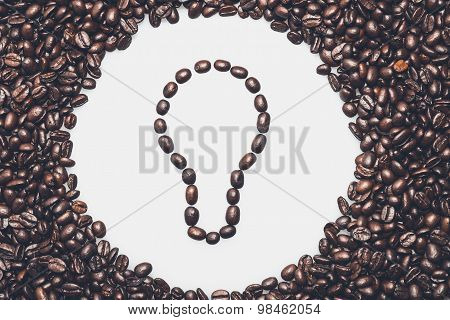 Coffee Texture With A Lightbulb Symbol