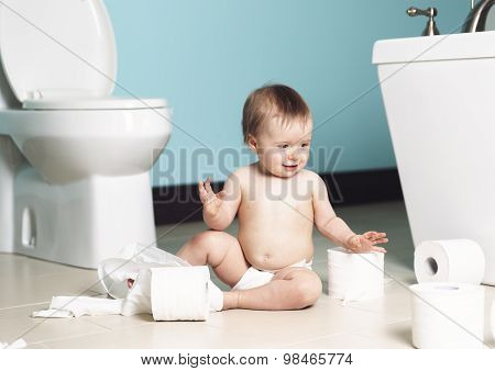 A Toddler ripping up with toilet paper in bathroom poster