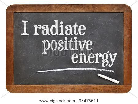 I radiate positive energy - positive affirmation words on a vintage slate blackboard