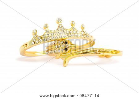 Gold bracelets dolphin and crown shape adorned with diamonds. Fake jewelry. Clipping path in picture. poster