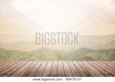 Wooden Floor With Mountain Landscape Blurred Background