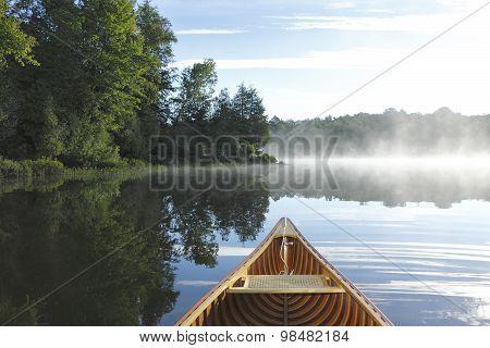Cedar Canoe Bow On A Misty Lake