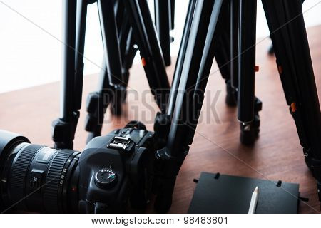 Tripods and Digital camera (DSLR) . Ready for filming or photo session. Photography equipment.