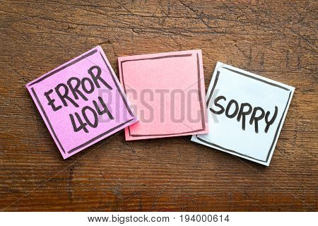 sorry, error 404 - web page not found sign  - handwriting in black ink on sticky notes against rustic wood with a copy space