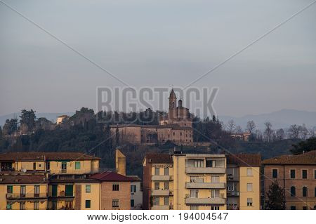 Italy Siena - December 26 2016: the view of typical old building in Siena and a church on background on December 26 2016 in Siena Tuscany Italy.