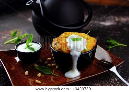 potato casserole with spinach,pine nuts and sour cream