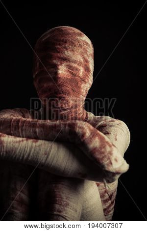 Creepy Blood Spattered Mummy Sits In Darkness