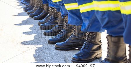Rescuers wearing uniforms standing in deployment