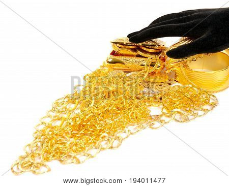 Lot of golden jewels and golden box, with black hand ower it