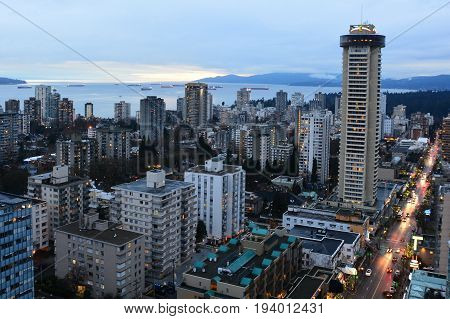 Vancouver BC,Canada,February 18th 2017.Vancouver skyline with condos and apartments,busy Robson street and English bay in the background.Come enjoy Vancouver.