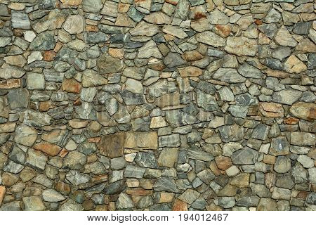 A well built rock wall gives us interesting shapes,sizes,pattern and texture to the eye.