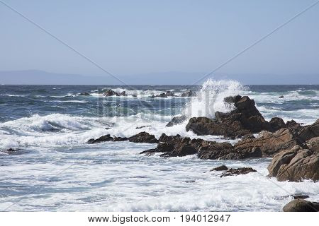 Surf Crashing along rocks along 17 mile drive Pebble Beach California