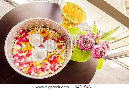 jasmine garland and jasmine and rose leaf in bowl for bless adults Thai traditional for Mother's day and Father's day in thailand.