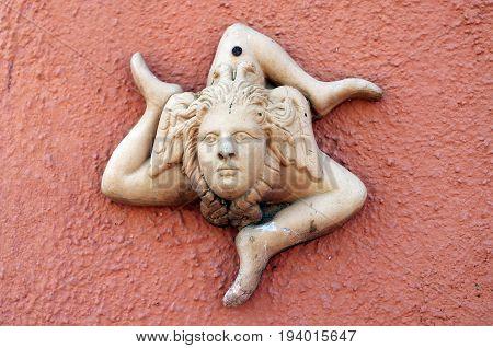 a strange terracotta symbol with three legs