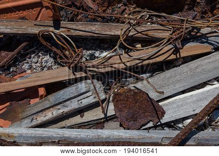 Garbage With Metal, Wood, Shells On Bonfire