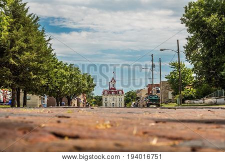 Horizontal photo of the old downtown area of Cottonwood Falls, KS with the courthouse at the end of the street (all logos edited out)