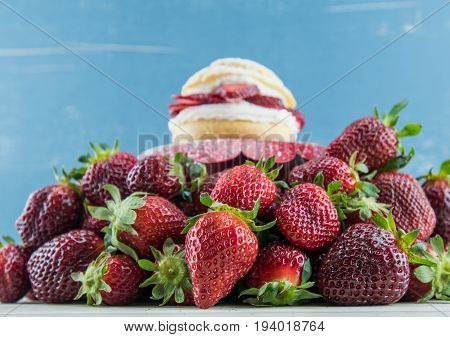 Heap of Berries on Table with Shortcake in Background