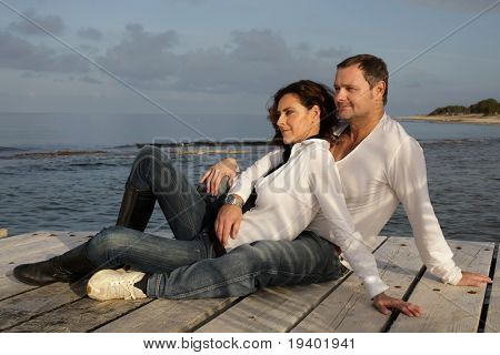 attractive couple on a pier
