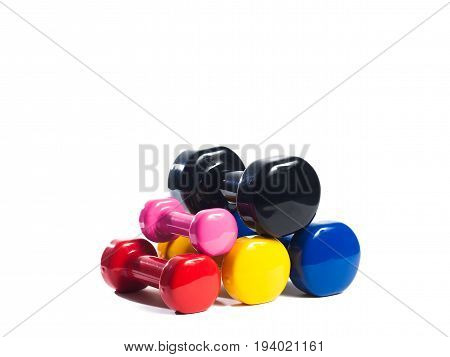 Five multi-colored metal dumbbells on an isolated background in three rows