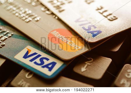 Bangkok Thailand - Jun 23 2015 : Group of credit cards on computer keyboard with VISA and MasterCard brand logos