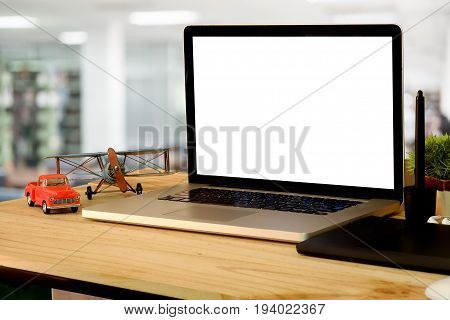 Laptop with blank screen on table. Man using laptop.