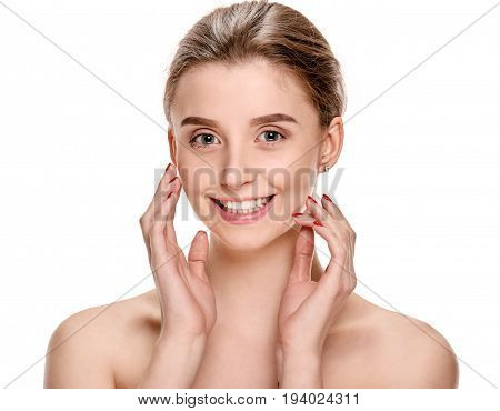 Happy smiling girl touching face after spa procedures