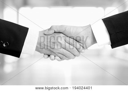 Handshake of businessman in black and white (monochrome) tone - greeting dealing merger and a acquisition concepts