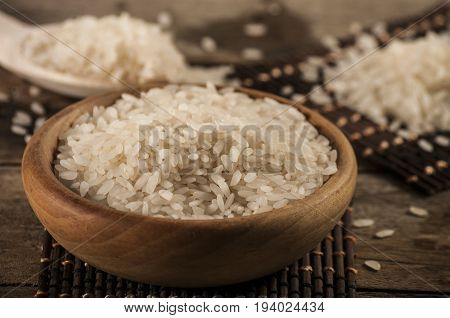 rice, jasmine rice, mali rice in Ladle and basket on the wood background