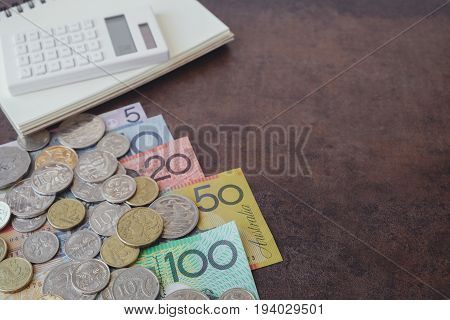 Australian money AUD calculator and notebook copy space background